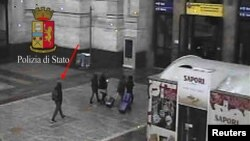 Anis Amri (L), the Tunisian suspect of the Berlin Christmas market attack, is seen in this photo taken from security cameras at the Milan Central Train Station in downtown Milan, Italy December 23, 2016.