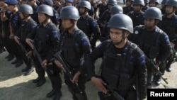 Police officers listen to an instruction during a ceremony as part of a security preparation ahead of commemorations of the tenth anniversary of the Bali bomb blasts, in Denpasar, Bali, October 10, 2012..