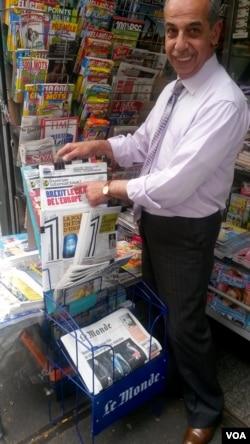 News vendor Louay Joud says he can't care less about Brexit. (L. Bryant/VOA)