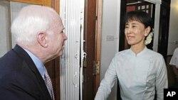 US Senator John McCain, left, bids farewell to Myanmar democracy icon Aung San Suu Kyi at her lakeside home after holding talks, June 2, 2011, Rangoon, Burma.