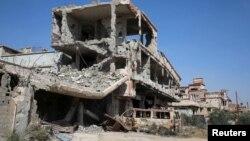 Des immeubles endommagés par des bombardements à Benghazi, Libye, 4 avril 2016.