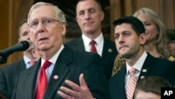Senate Majority Leader Mitch McConnell speaks on Capitol in Washington, Thursday, Dec. 8, 2016. From left are, McConnell, Rep. Tim Murphy, House Speaker Paul Ryan, and Max Schill, 7, who suffers from Noonan Syndrome.