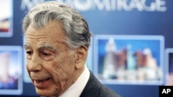 FILE - Kirk Kerkorian, speaks to reporters at the Nevada Gaming Control Board hearing in Las Vegas, Feb. 22, 2005.