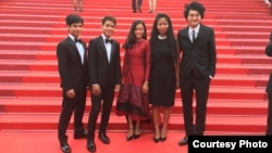 From left to right: Nov Cheanick, Chhem Madeza, Nuon Sobon, Tith Kanitha, Davy Chou posed for a photo on the official red carpet the day of the official screening of the film, Friday 13, May 2016. Actors' clothes were designed by Colorblind and actress' dress by Kool as U. (Photo: Barbara Lombeek)