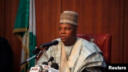 "FILE - Borno state Governor Kashim Shettima on Saturday commended security and vigilante forces, saying that the death toll in a Boko Haram raid on the village of Zabarmari would have been much higher had it not been for their ""gallantry."""