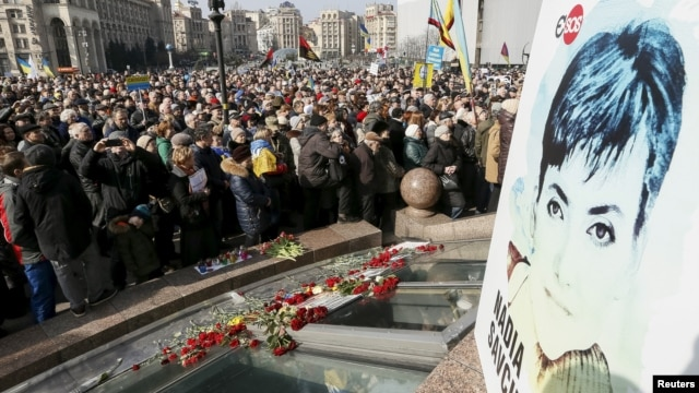 People take part in a rally in central Kyiv, Ukraine, demanding liberation of Ukrainian army pilot Nadezhda Savchenko by Russia, March 6, 2016.
