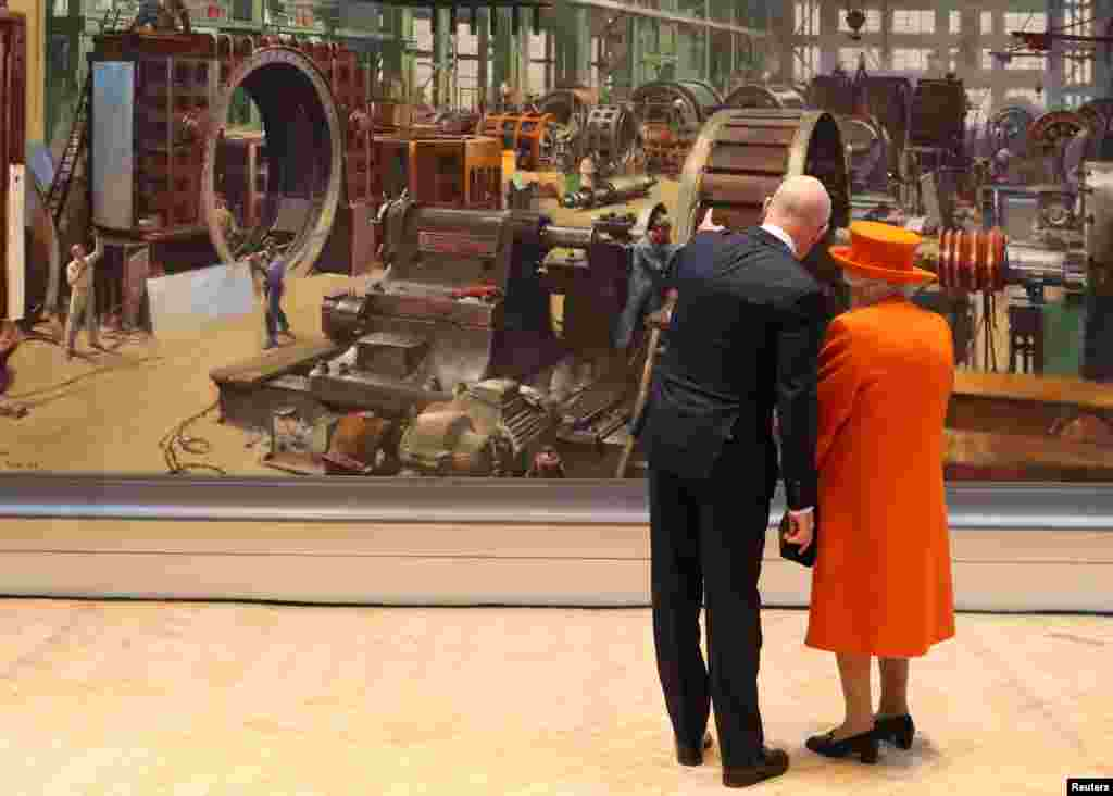 Britain's Queen Elizabeth views a painting with Science Museum Director Ian Blatchford during a visit to the museum in London.