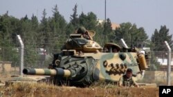 FILE - A Turkish army tank is seen near the Syrian border in Suruc, Turkey, Sept. 3, 2016. Since then, tanks have entered Syria's Cobanbey district as part of the Euphrates Shield operation to aid Syrian rebels against the Islamic State group.
