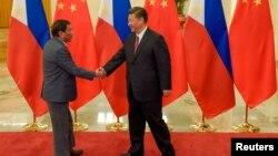 菲律賓總統杜特爾特上任後訪問中國與習近平會晤資料照。