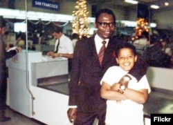 Young Barack Obama with his father