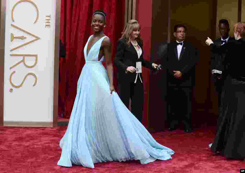 Lupita Nyong'o arrives at the Oscars on March 2, 2014, at the Dolby Theatre in Los Angeles.