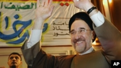 FILE - Former Iranian President Mohammad Khatami gestures as he tours Al-Azhar Mosque and University in Cairo, March 29, 2007.