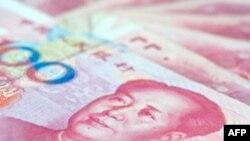 中国拒人民币快速升值强调货币稳定