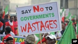 A protester holds a banner during a demonstration against a fuel subsidy removal in Lagos, Nigeria, January 9, 2012.