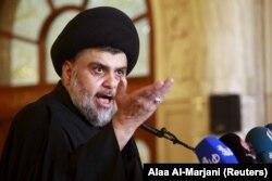 Necef'te cuma namazı sırasında halkı bugünkü gösterilere katılmaya çağıran Iraklı Şii lider Mukteda el Sadr
