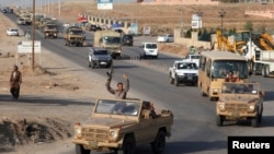 Іракські курди в дорозі до Кобані, щоб помогти сирійським курдам у боротьбі з ісламськими екстремістами