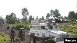 South African peacekeepers patrol the streets of Goma in the eastern portion of the Democratic Republic of the Congo, Dec. 2, 2015.