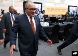 Papua New Guinea Prime Minister Peter O'Neill inspects the APEC 2018 International Media Center at Port Moresby, Papua New Guinea, Nov. 14, 2018.