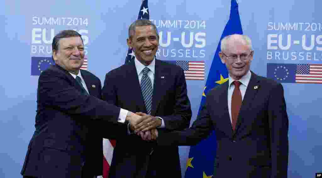President Barack Obama shakes hands with EU Council President Herman Van Rompuy and EU Commission President Jose Manuel Barroso prior to an EU-US summit meeting in Brussels, March 26, 2014.