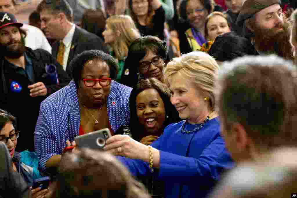 Democratic presidential candidate Hillary Clinton takes pictures with supporters after a campaign event at the Central Baptist Church in Columbia, S.C., Feb. 23, 2016.