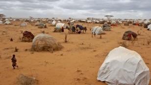 A child runs, left, at a refugee camp in Dadaab, Kenya, Aug 4, 2011.