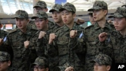 South Korean army soldiers pose before leaving for Haiti at the Incheon International Airport, in South Korea, Wednesday, 10 Feb. 2010