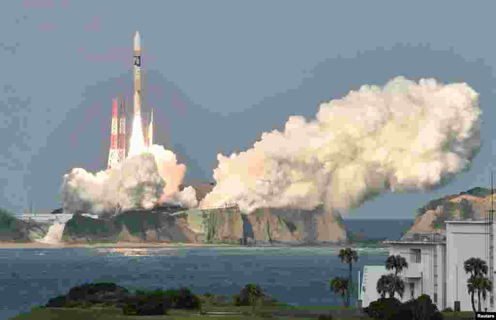 "n H-2A rocket carrying Japan Meteorological Agency's new weather satellite ""Himawari-9"" is launched at Tanegashima Space Center on the Japanese southwestern island of Tanegashima, Kagoshima Prefecture, in this photo taken by Kyodo."