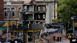 Firefighters view the aftermath of a building collapse in Philadelphia, Pennsylvania, June 6, 2013.