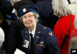 FILE - Wearing her WASP uniform from World War II, Eleanor Brown of Victoria, Texas, attends a Congressional Gold Medal ceremony on Capitol Hill in Washington, honoring the Women Airforce Service Pilots (WASP), March 10, 2010.
