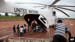 FILE - A World Food Programme (WFP) truck backs up to load food items from a recently landed UN helicopter, in Yida camp, South Sudan.