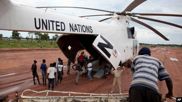 FILE - A World Food Program (WFP) truck backs up to load food items from a recently landed UN helicopter, in Yida camp, South Sudan. Ban's visit comes as implementation of the peace agreement signed last August between President Salva Kiir and his former vice president, Riek Machar, is proceeding only slowly.