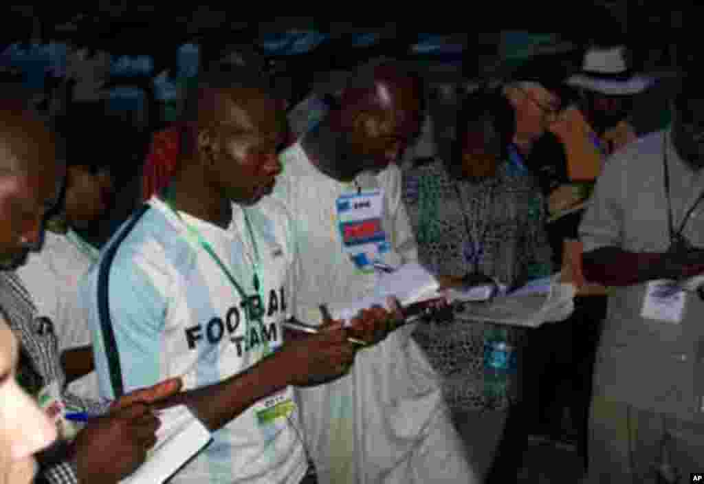 Party agents recording the results of parliamentary elections at a polling station in Abuja, Nigeria's capital
