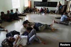 Pakistan refugees rest inside a mosque in Negombo, Sri Lanka, April 25, 2019.