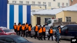 FILE - Inmates are being escorted to perform work at a penal colony in Krasnoyarsk, Russia, Dec. 20, 2013. Beginning with 2017, the Russian correctional system will introduce forced labor as an alternative to traditional prison sentences.