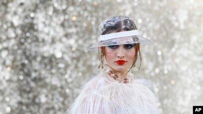 5900cbea3449 A model wears a creation for the Chanel Spring Summer 2018 ready-to-