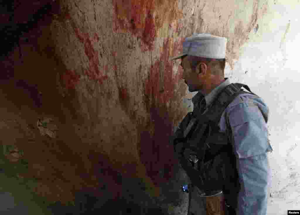 Blood is seen on the wall of a building after an attack in Kabul, June 10, 2013.