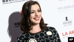 Anne Hathaway attends The LA Art Show and The LA Fine Art Show Opening Night Premiere Party held at the LA Convention Center on Jan. 27, 2016, in Los Angeles.