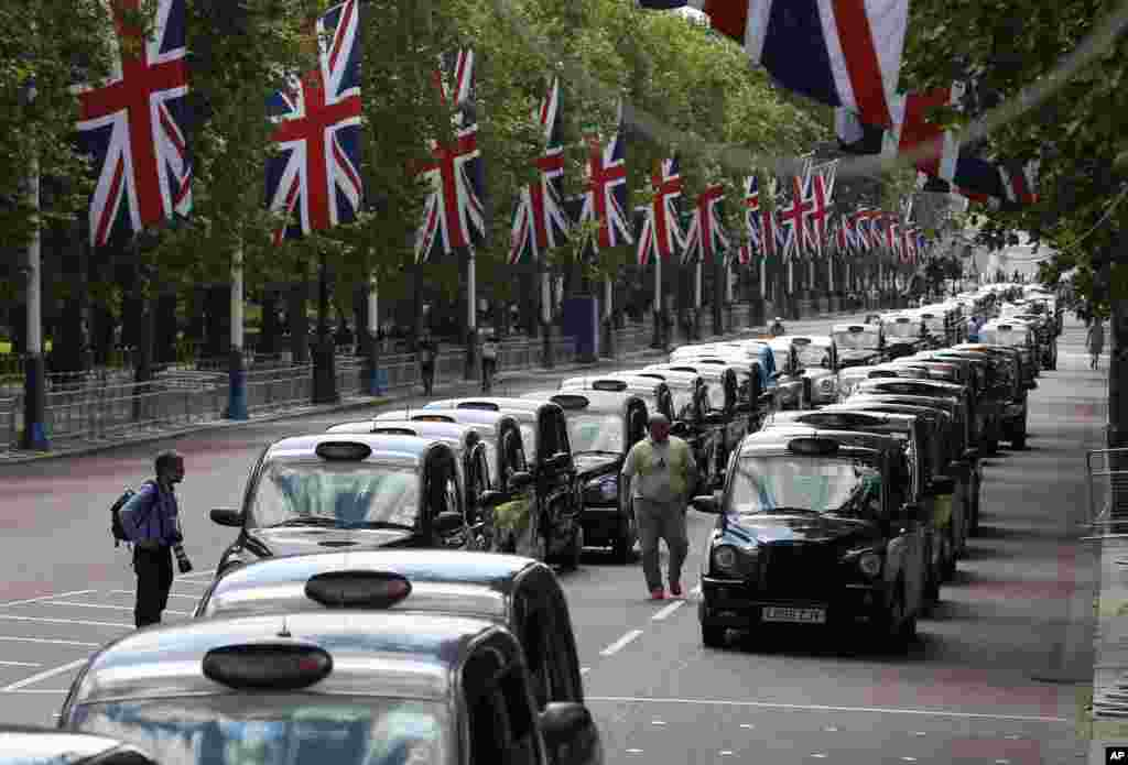 Traditional London black cabs line up along The Mall as taxi drivers block the street to protest over new technology they say endangers passengers, in London. The strike action by taxi drivers hit many European cities sparked by fears about the growing upheaval in the travel and transport industry, largely due to digital technologies.