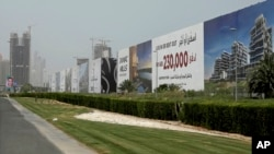 In this Wednesday, June 6, 2018 photo, billboards advertise luxury villas and apartments in Dubai, United Arab Emirates. A new report released Tuesday, June 12, 2018, by the Washington-based Center for Advanced Defense Studies, relying on leaked property data from the city-state, described Dubai's real-estate market as a haven for money launderers, terror financiers and drug traffickers sanctioned by the U.S. in recent years. Officials in Dubai said they could not comment on the report. (AP Photo/Kamran Jebreili)