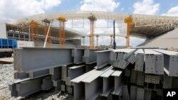 FILE - Steel beams sit outside the Arena de Sao Paulo in Sao Paulo, Brazil, Dec. 8, 2013.