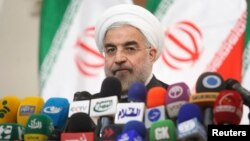 Iranian President-elect Hassan Rohani speaks with the media during a news conference in Tehran, June 17, 2013.