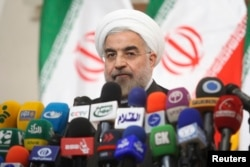President-elect Hassan Rouhani speaks with the media during a news conference in Tehran, June 17, 2013.