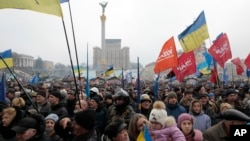 Opposition supporters take part in a rally in Kyiv's Independence Square in Ukraine, Feb. 9, 2014.