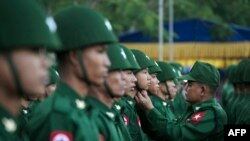 (FILES) In this file photo taken on February 12, 2020, members of the Myanmar military honour guard take part in a ceremony to mark the 73rd National Union Day in Yangon. - Myanmar's army chief has raised on January 27, 2021 the prospect of scrapping the