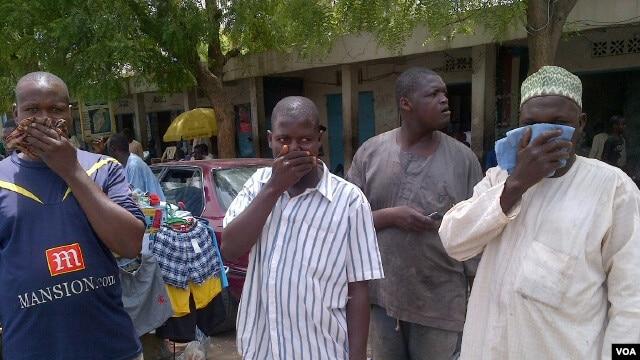 Traders who speak to Blueprint use scented handkerchief to cover their noses, Maiduguri, Nigeria, June 4, 2012. VOA / Kareem Ogori