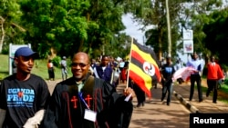 Anti-gay Pastor Martin Ssempa carries national flag while leading procession for Uganda's anti-gay bill, Kampala, March 31, 2014.