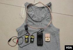 A hidden coil in a shirt, two batteries, a mobile phone and a receiver were found on a student and confiscated by the authorities as cheating equipment for a Chinese test in Chengdu, Sichuan province in 2014. (REUTERS)