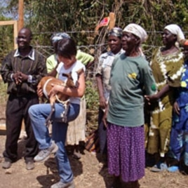 B1G1 founder, Masami Sato (C) holds a goat donated through her company at the World Youth International Mama Ann Odede Complex in western Kenya (File)