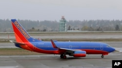 FILE - A Southwest Airlines plane taxis at the Seattle-Tacoma International Airport in Seattle, April 13, 2018.