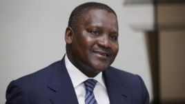 In this photo taken October 8, 2012, Nigerian billionaire businessman Aliko Dangote  attends  a global business environment meeting in Lagos, Nigeria.